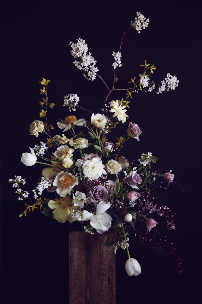 a dramatic and bohemian centerpiece or flower arrangement