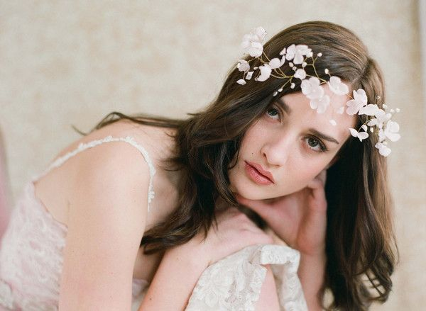 forgo a tradional veil and use flowers in your hair......its very delicate