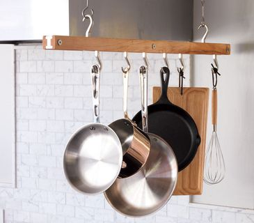 The fab five: A good frying pan, a saucepan, a large sauté pan, a cast-iron skillet, and a stockpot will handle the vast majority of your needs. Hang everything except the stockpot from a small ceiling-mounted rack or a pegboard on the wall. Bar pot rack, $85, jkadams.com.