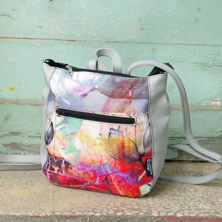 "Backpack ""Grey Tulip"" A bag which carries the emblem of absolute love, in a hue of sweet melancholy. Collage with strong contrast, from a timeless gray to the lighthearted purple and dreamy coral."