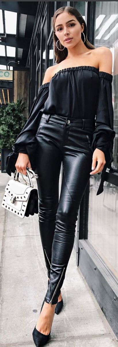 Who made Olivia Culpo's black off the shoulder top, leather skinny pants, jewelry, white handbag, suede pumps?