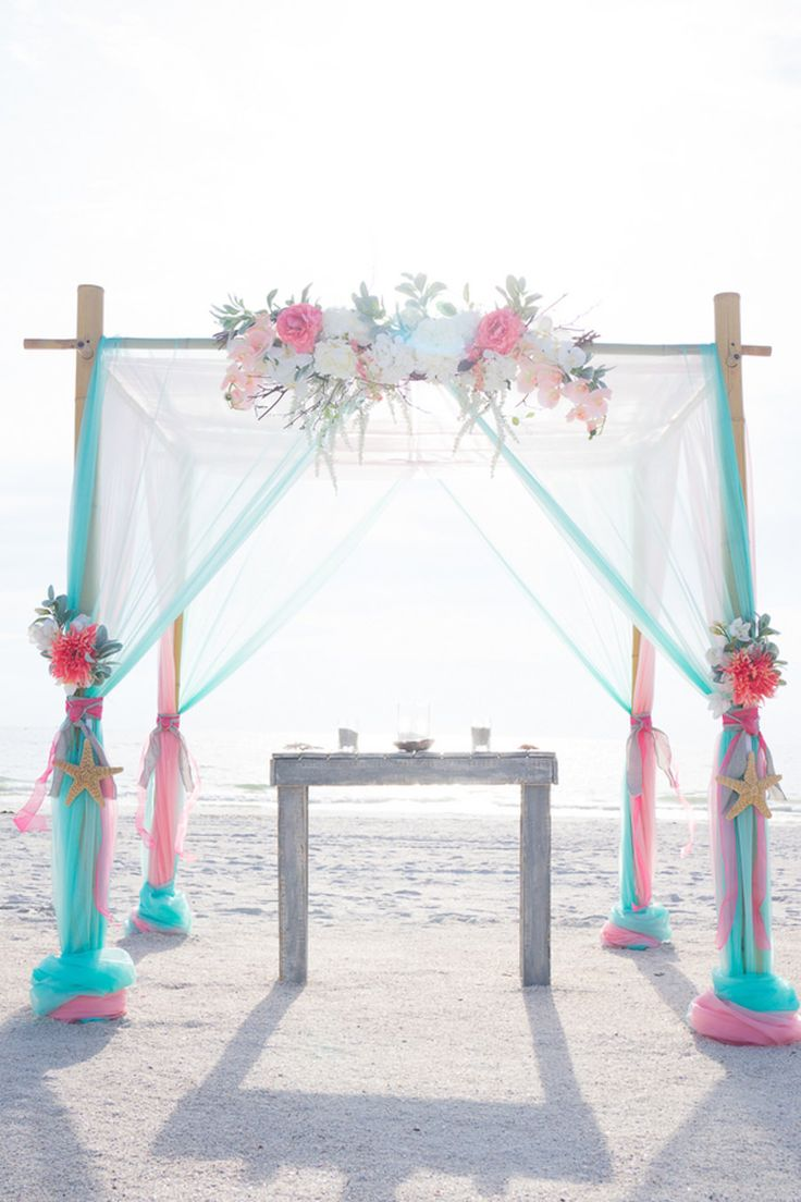 Beach Waterfront Wedding Ceremony With Bamboo Altar And Pink Teal Floral Draping Accent
