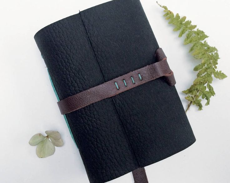 Deep dark and mysterious! An A7 format writers journal, or leather sketchbook, made from deepest black grained leather.  Take a look...  https://www.etsy.com/uk/listing/575150379/writers-journal-leather-sketchbook-3rd?ref=shop_home_feat_4