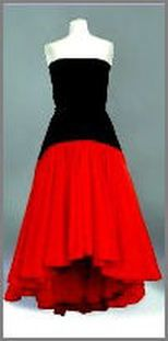Strapless ball gown with black velvet and a red taffeta skirt in a flamenco style. Designed by Murry Arbeid. Diana accessorized this dress with one red glove, one black glove and also with a Maltese cross brooch made by Butler and Wilson. Diana wore this dress on many occasions, but not always with the brooch. This gown was among those in the Christie's auction in 1997. The dress sold for $ 25,300.00 in the Christie's auction.This is one of my favorite 'Diana Dresses'