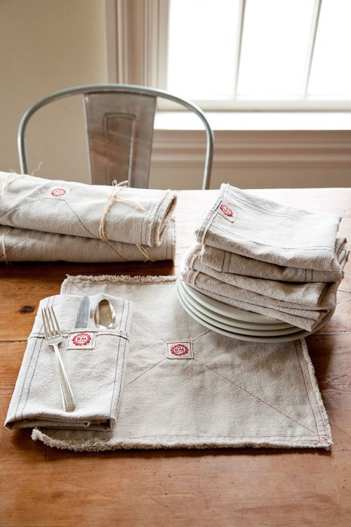 Wonderful American made placemats and napkins, several styles of aprons