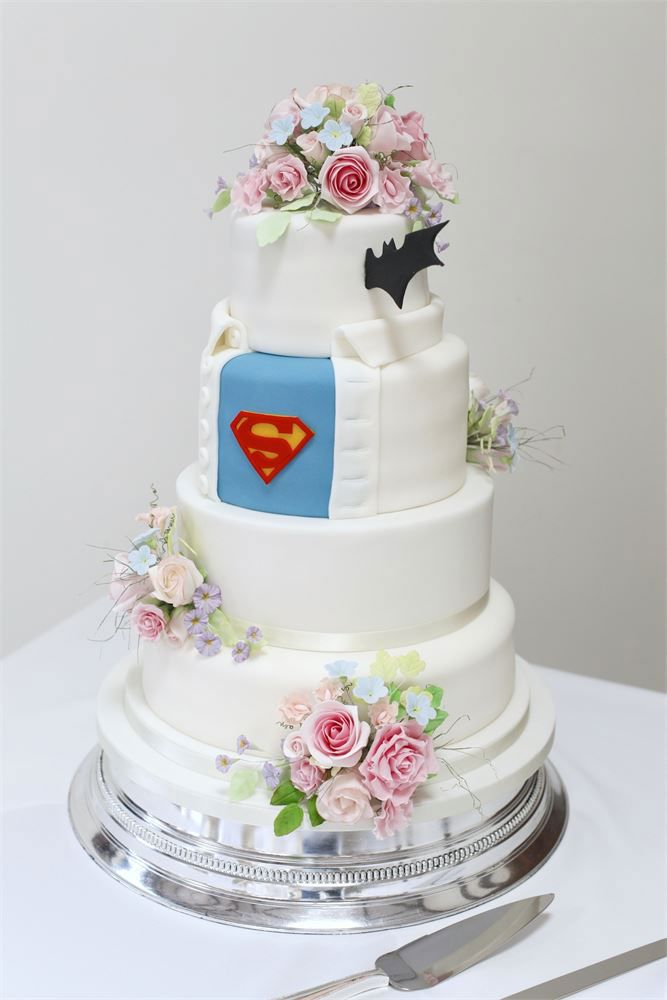 This is without a doubt one of the prettiest superhero wedding cakes that we've ever seen. If you want a floral wedding cake and he wants something comic book themed, then this treat by Kasserina Cakes is your compromise