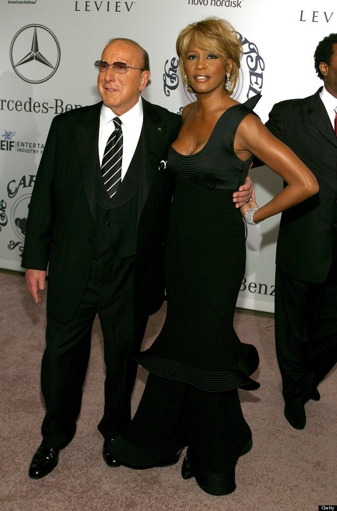 17th Mercedes-Benz Carousel of Hope Ball - Arrivals  BEVERLY HILLS, CA - OCTOBER 28: Producer Clive Davis (L) and singer Whitney Houston arrive at the 17th Annual Mercedes-Benz Carousel of Hope Ball at the Beverly Hilton Hotel on October 28, 2006 in Beverly Hills, California. (Photo by Michael Buckner/Getty Images) - Armani dress?