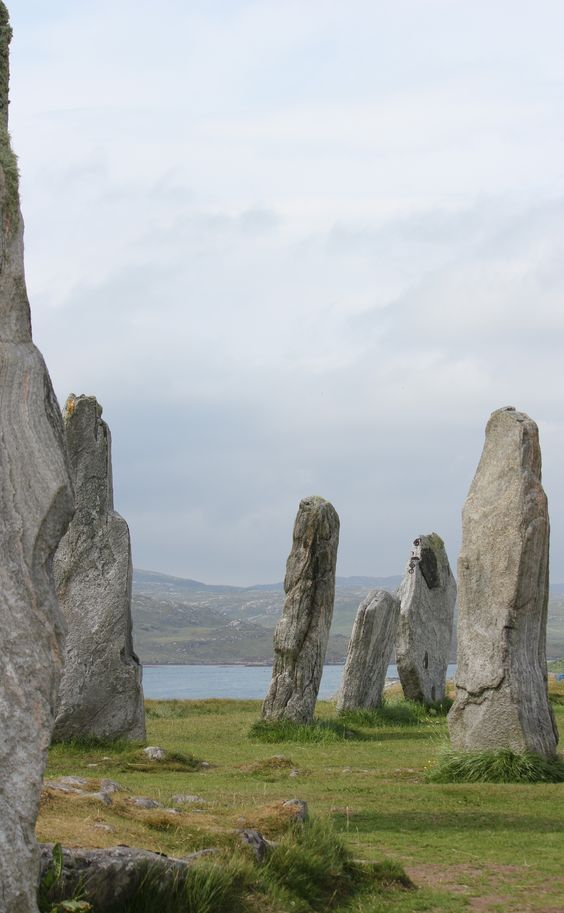 """The Callanish Stones (or """"Callanish I"""", Clachan Chalanais or Tursachan Chalanais in Scottish Gaelic) are an arrangement of standing stones placed in a cruciform pattern with a central stone circle. They were erected in the late Neolithic era, and were a focus for ritual activity during the Bronze Age. They are near the village of Callanish (Gaelic: Calanais) on the west coast of Lewis in the Outer Hebrides, Scotland."""