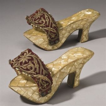 A pair of 20th century Ottoman Algeria mother-of-pearl inlaid wood womens shoes.     from batashoemuseum.ca    The qabqab is a traditional women's shoe of the Ottoman Empire. An intricately inlaid wooden clog designed to be worn to and from the bath house, the kabkab can be over six inches in height, and keeps the wearer's feet clean and away from the heated floors
