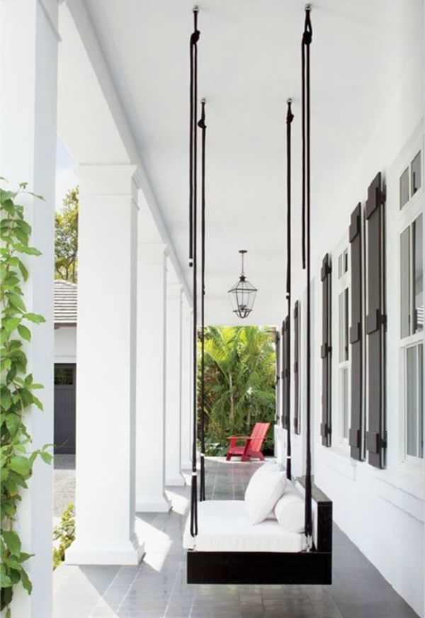 Porch perfection = a gorgeous swing built by D & A Studio, a charred iron lantern from Farrey's, and a red Adirondack Chair from DWR. Featured in Luxe magazine, summer 2012.