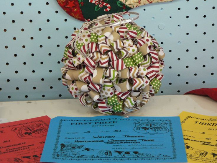"""Christmas Ball made to put into  our local show and i won first place :) Made with season of style dsp stack, silver 1/8"""" ribbon,Styrofoam ball and silver pins"""