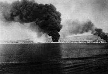 Spain - 1936. - GC - Arde la ciudad. Málaga en llamas