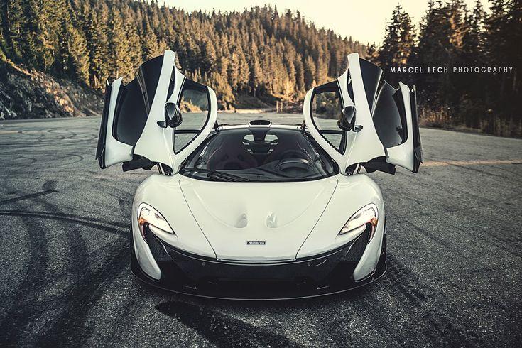 stunning white mclaren p1 doors up; front angle - sssupersports.com