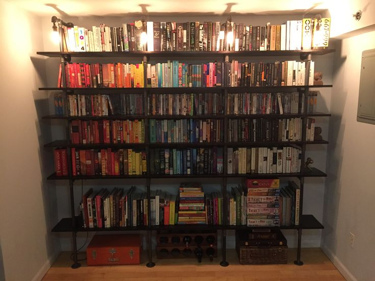 Moved in with GF. Decided to build pipe shelves with custom lights to house our combined book and movie collection. First Post. - Album on Imgur