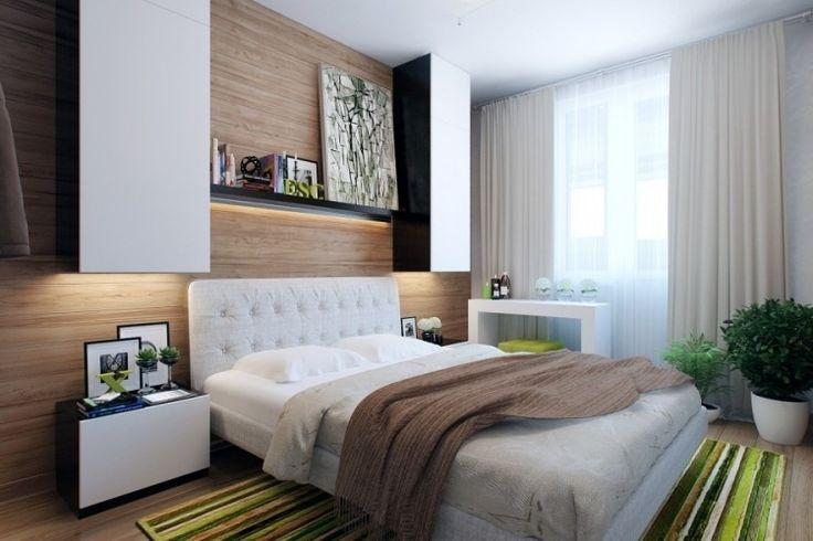 Holzwandverkleidung und weiße Schlafzimmermöbel - grüne Akzente