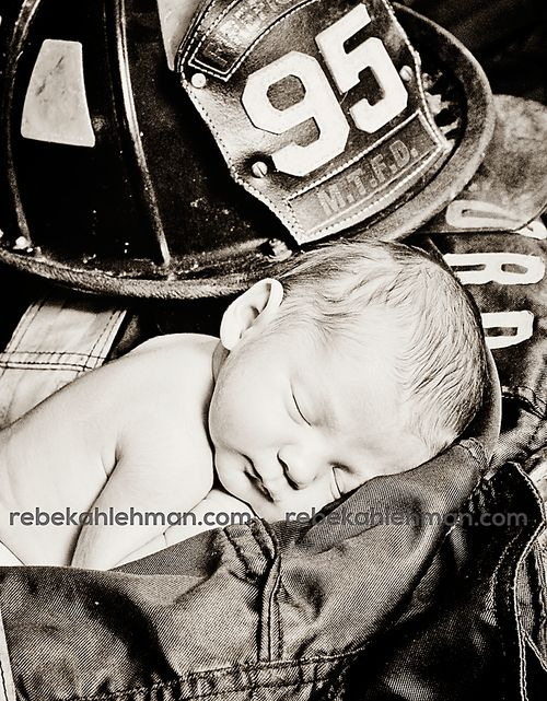 If we have more kids I am definitely taking a picture like this with Odus' firefighter uniform...so adorable!