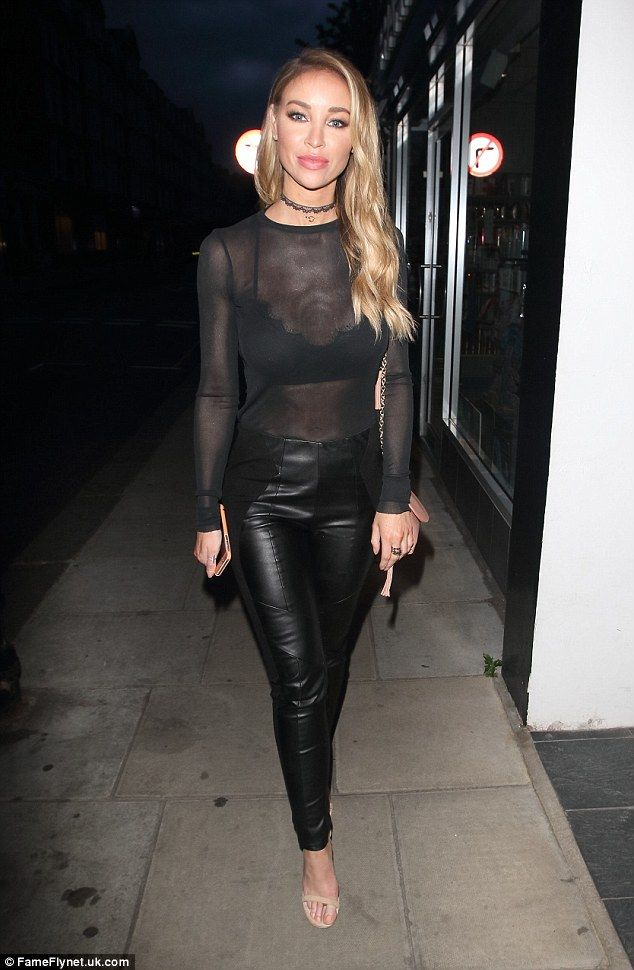 Showing off: Lauren Pope flashed a hint of her bra and her incredibly toned abs in a sheer top when she headed out to Kiru restaurant in Chelsea, London on Saturday night