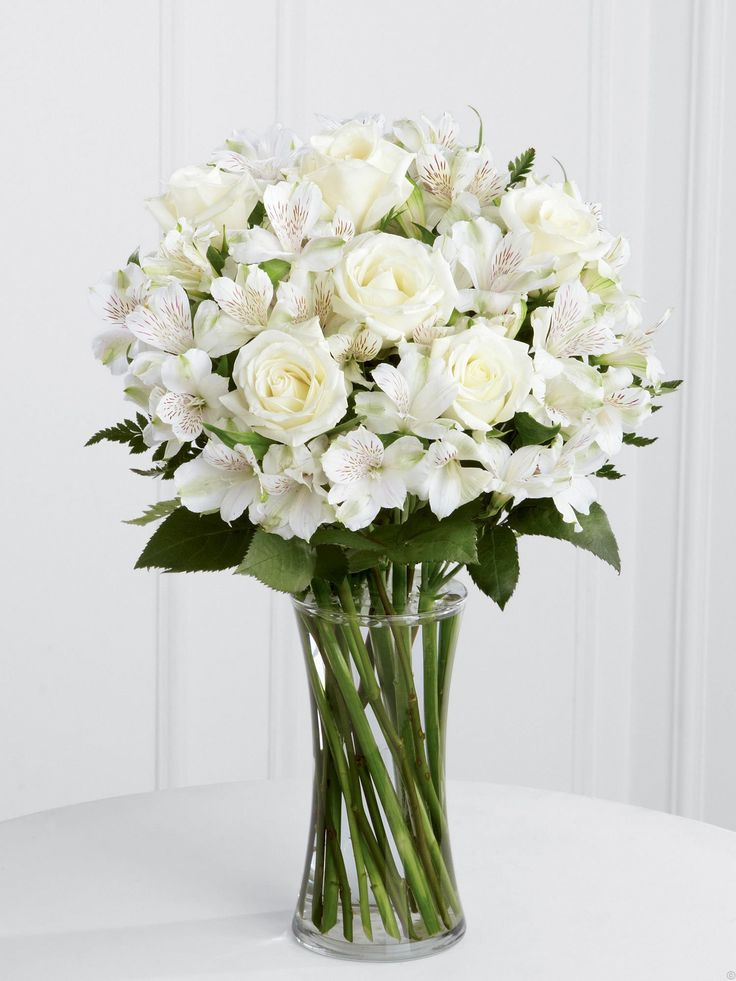 Pure white flowers in a clear vase. .Luxury White Rose & Alstroemeria Vase from Venus Flowers,Manchester, UK.