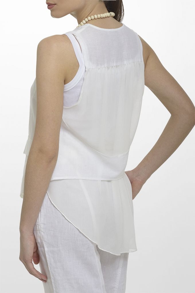 Sarah Lawrence - linen vest with see through back details, sleeveless cotton tank, linen loose trouser, long layer necklace.