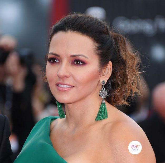 Luciana Damon wearing emerald tassel earrings by Narcisa Pheres at the premiere of 'Suburbicon' - 74th Annual Venice Film Festival