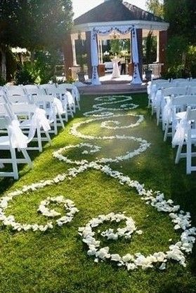 Would like a design like this down the aisle in navy flower petals (so it stands out on the concrete)