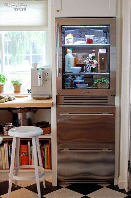 This is actually two separate units stacked on top of each other from True.  The drawers are all-refrigeration, not freezer.  True Glass Front Refrigerator
