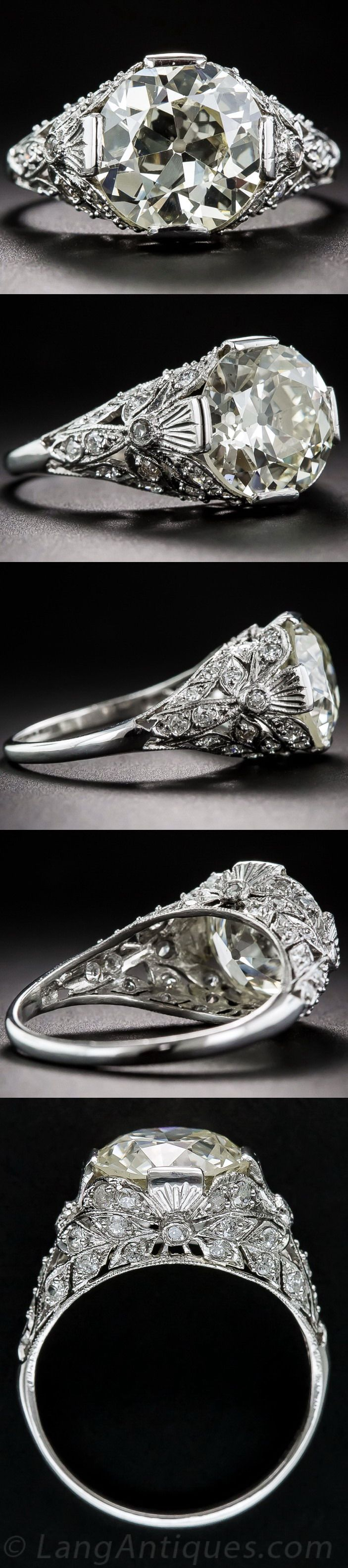 3.90 Carat European-Cut Diamond Platinum Art Deco Engagement Ring. The very impressive and flashy stone radiates from atop its original 1920-30s-era platinum and diamond mounting thoroughly adorned all around with small glittering diamonds set into stylized foliate inspired settings. Delicate hand engraved milgraining adds the finishing touch to this dynamic Art Deco dazzler in finger size 6 3/4.