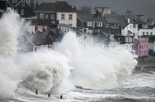 Storm battering seafront, Lyme Regis, Jurassic Coast World Heritage Site, Dorset, England.  Picture: Guy Edwardes/Bluegreen Pictures/Rex Features