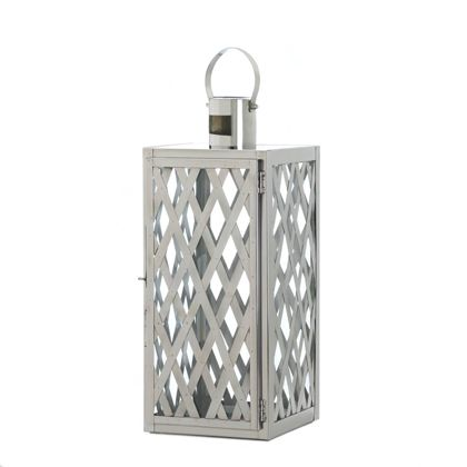 <p>Turn simple candlelight into a show-stopping design element with this stunning steel candle lantern. The silvery lattice design will make your favorite candle stand out with style. Features a hinged door and top hanging loop.</p>