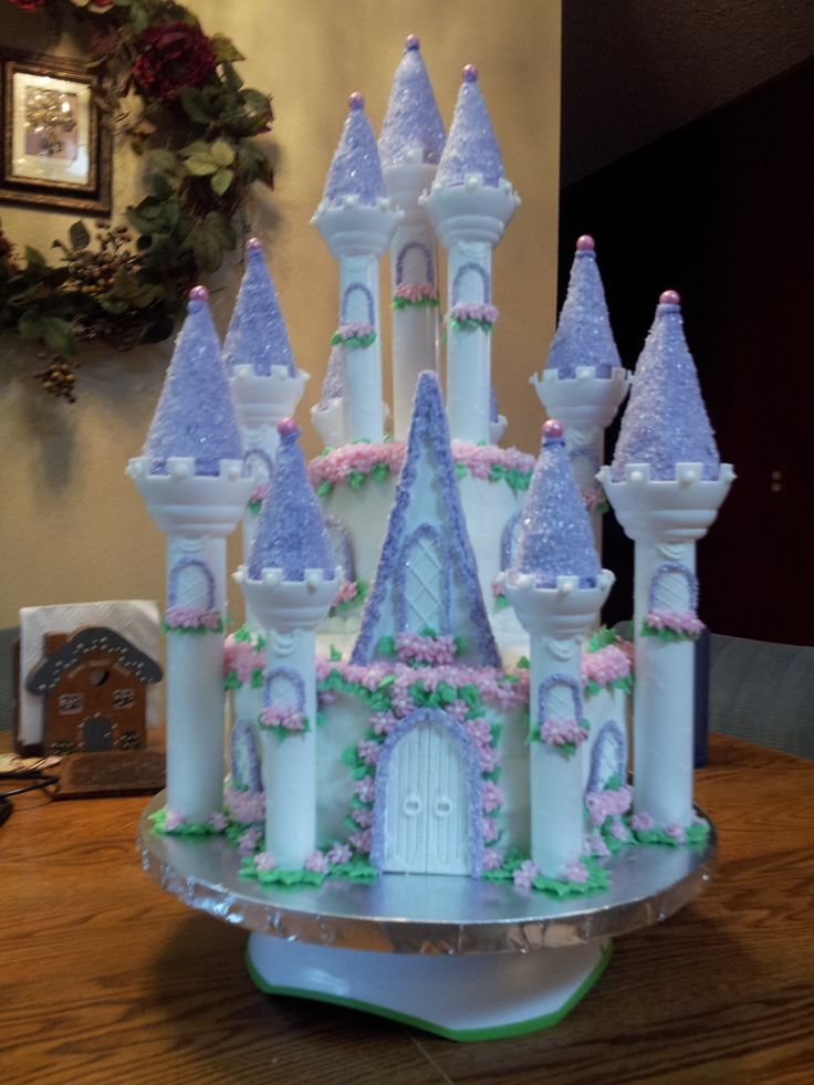 Granddaughter's 1st princess birthday cake.  Time consuming but not too hard.  Beautiful!  I used Wilton Castle Cake Set and their diections.  You can find everything you need at wilton.com! Even have cool ideas for boy Knight castles!