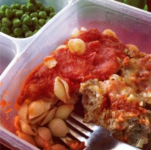 single serving of Chicken Parmesan Mini Meatloaf with pasta and marinara and peas
