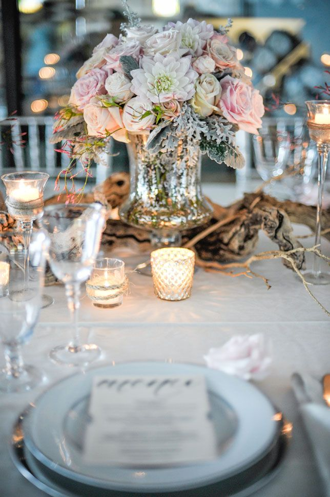 Amazing wedding centerpiece idea.  Mercury glass vase, dahlias,garden roses, dusty millers | Half Full Photography