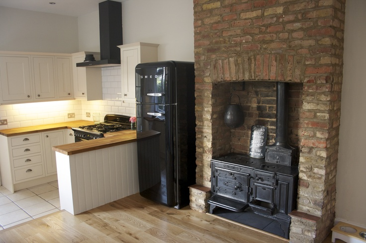 Our new kitchen with the original range cooker that came with the Edwardian house.