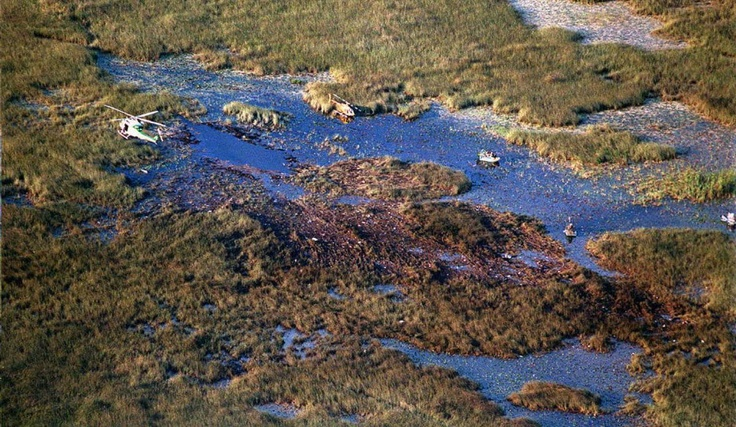 ValuJet Crash Of 1996 ~ A rescue hellicopter (L) and airboats look through the debris of Valujet Flight 592 after the DC-9 crashed 11 May some 20 miles NW of Miami International Airport