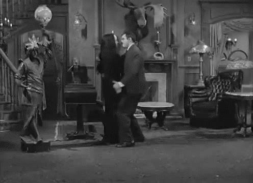 Morticia and Gomez Addams dancing