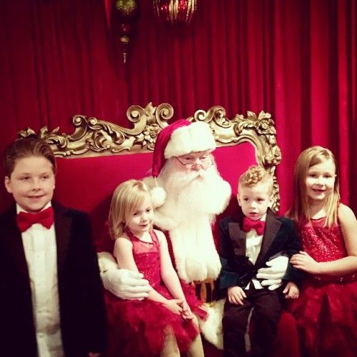 """""""Beverly Hills 90210"""" alum Tori Spelling shared a festive family photo of her 4 kids: Liam, 7, Stella, 6, Hattie, 3 & Finn, 2   """"1st year for all 4 seeing Santa & no tears! #bigmilestone We love our Santa! #Christmas14@thegroveLA, the proud mama, 41, Instagrammed the shot of her kids sitting on Santa's knee   The McDermott sibs wore matching outfits -w/ the boys in black tuxedos & bow ties & the girls in red Christmas dresses- as they visited Santa Claus at The Grove in W. Hollywood…"""