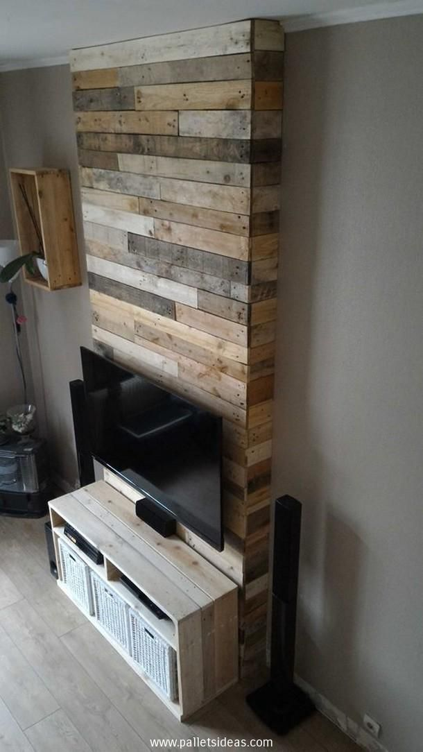 Don't think this is just an ordinary wood pallet recycled TV stand but we can also see very decent wood pallet wall cladding all along, while on the base we see a delicate wooden pallet cabinet too where all the related stuff can be put inside.