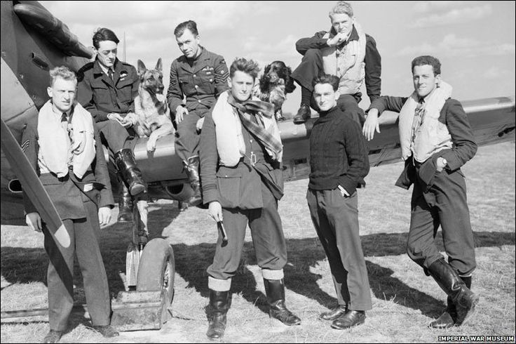 Pilots & dogs in front of Spitfire, 1940