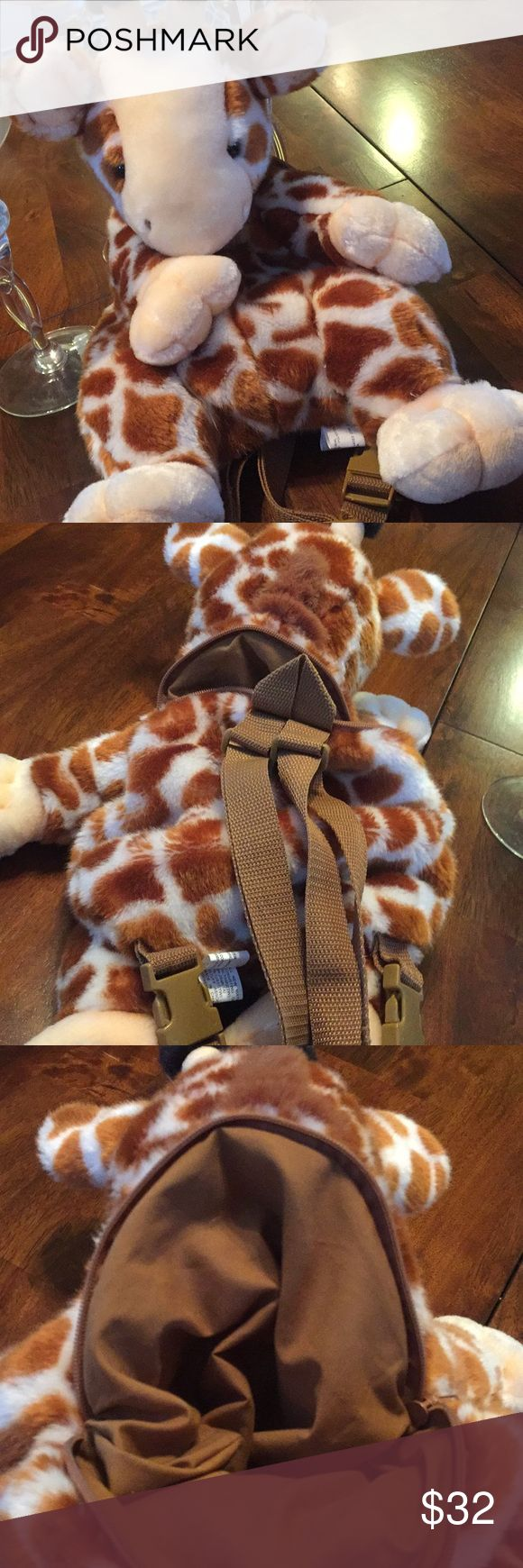 💜Giraffe Lovers Backpack SALE!💜 Super adorable giraffe backpack for all the giraffe lovers!  Super soft and cuddly! Back of backpack has zipper and storage and backpack straps. Super cute and one of a kind.  Never used; brand new!!   A perfect present! Accessories Bags