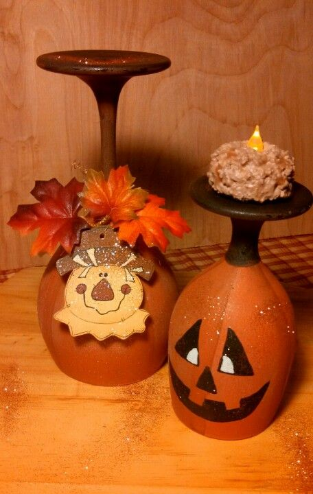 Old wine glasses turned fall candle holders for a centerpiece. Try making these with plastic glasses for a more durable craft