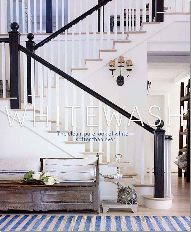 dark banister, light treads and floor