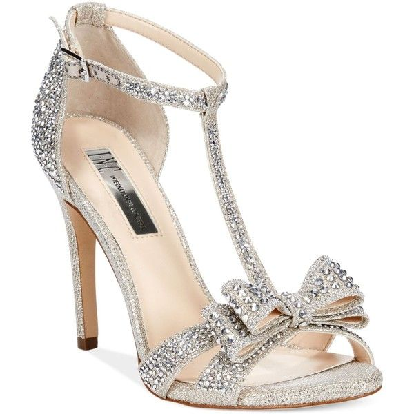 What's prettier than sparkles and bows? Not much. INC International's Reesie evenings sandals feature a t-strap styled vamp with a dazzling bow accent on the t…