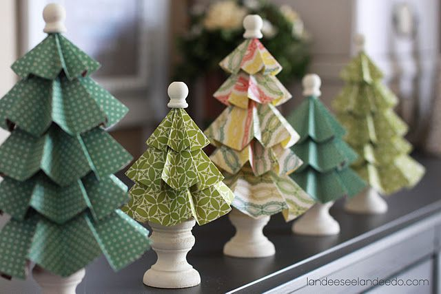Folded paper trees - supplies needed are cardstock, bamboo skewers, wood candlestick holders, wooden finials, and hot glue.