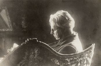 William Butler Yeats reading at home