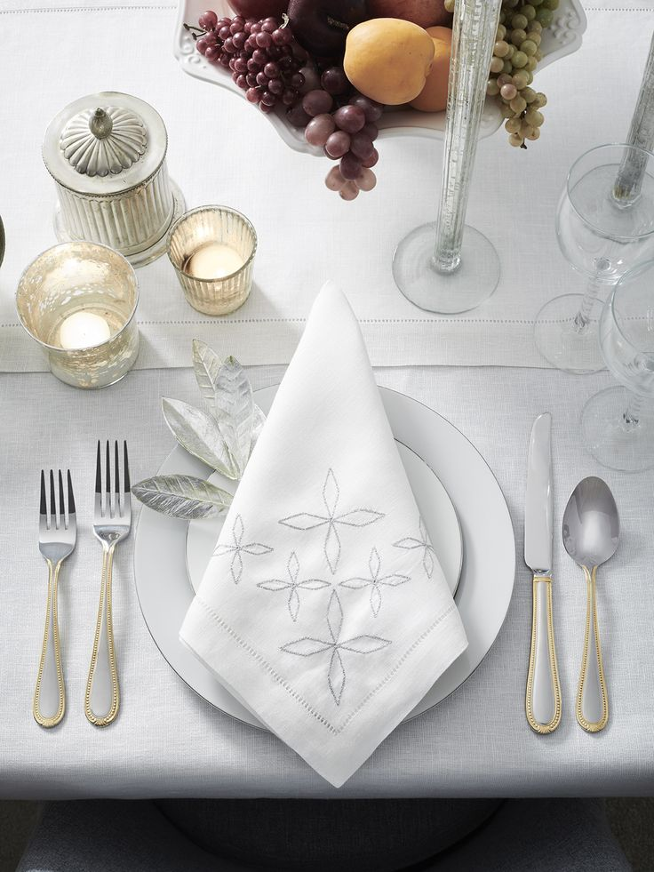 Our Seaver napkins bring the tradition of celebration and light through a cluster of delicately embroidered stars against pure white linen. The faint glimmer of the metallic thread reflects the glamour of our Reece tablecloth.