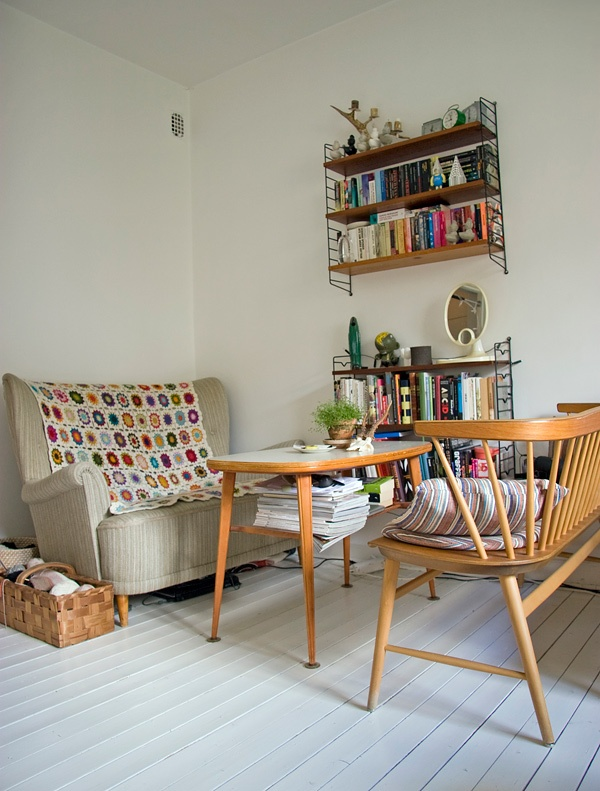 living room. Like the long chairseat in foreground. I think its an Ercol.