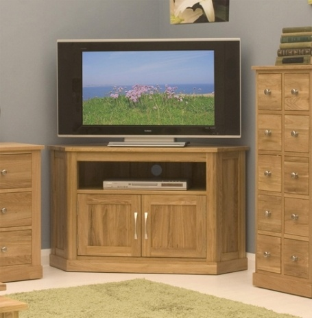 """The Mobel Oak Corner TV Cabinet is crafted to a contemporary design with open shelves designed to hold a DVD player and 42"""" TV. With a hardwood back, brushed steel handles and a resilient lacquer this cabinet would bring a touch of sophistication to an interior.  £371.70"""