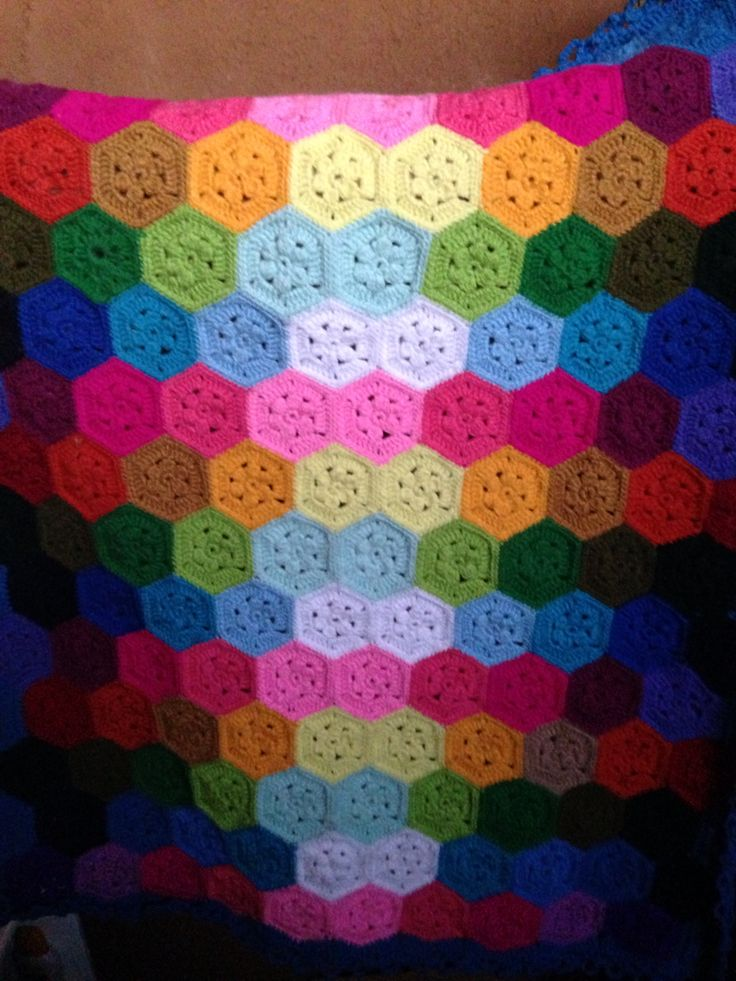 Crocheted baby blanket made of hexagons... Lots of them