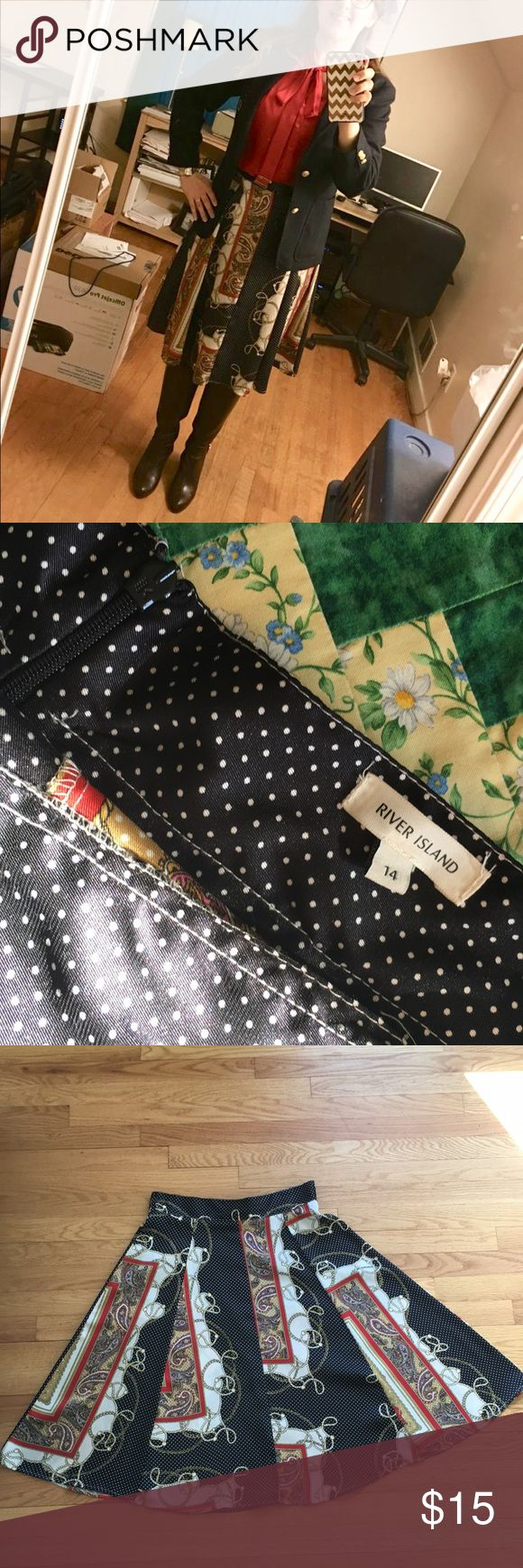 River Island midi skirt Flowy midi skirt with mixed pattern (paisley, polka dot, chain). Silky material. This is River Island UK brand, so tag size is 14 which converts to American 10. Waist measured approximately 32 inches. Hidden back zipper closure and 2 side belt loops. River Island Skirts Midi