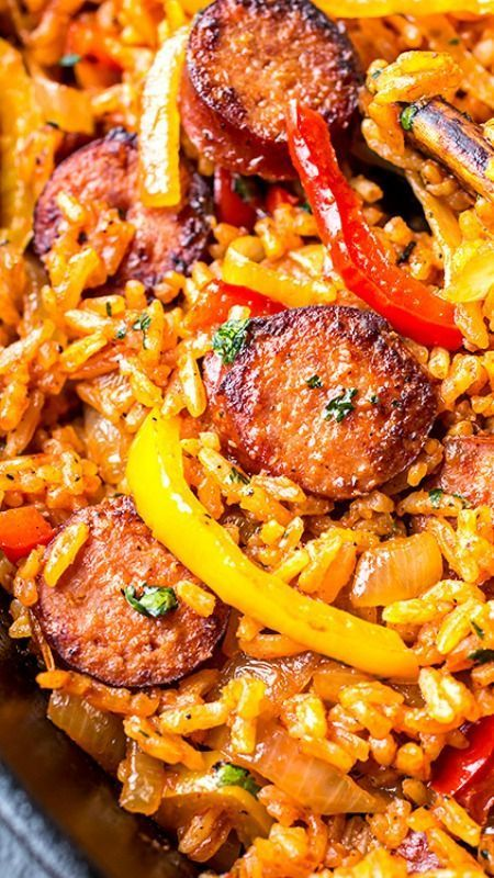 Smoked Sausage and Red Rice Skillet with Charred Onions and Peppers ~ juicy, savory, salty, smoky, tangy, bright and bold.